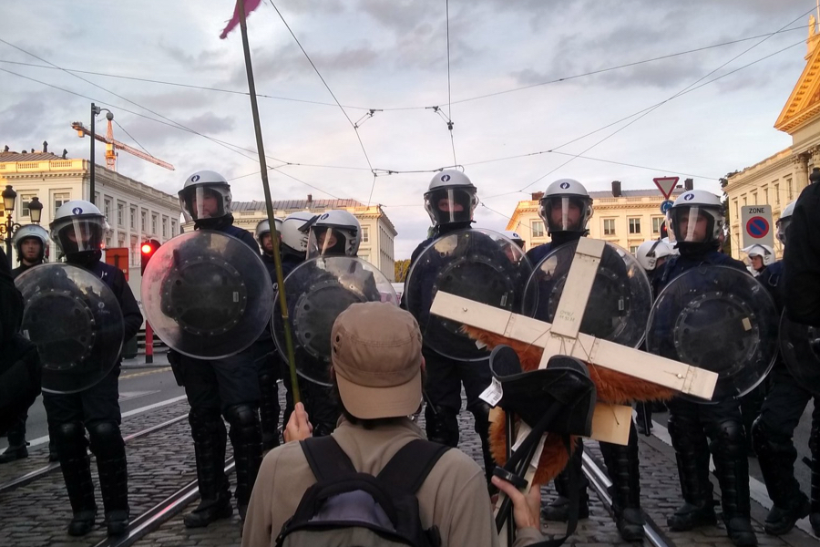 An activist surrounded by police at the Royal Rebellion on Saturday 12th October, 2019