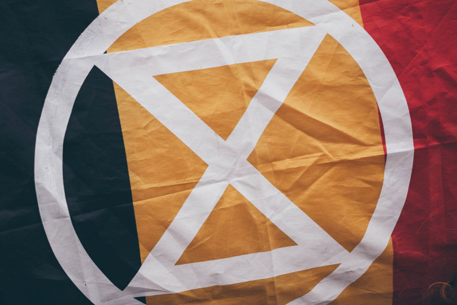 Belgian flag with an Extinction Rebellion logo