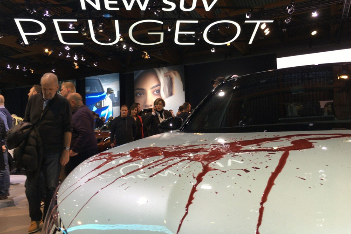 Peugeot SUV decorated with fake blood by XR activists